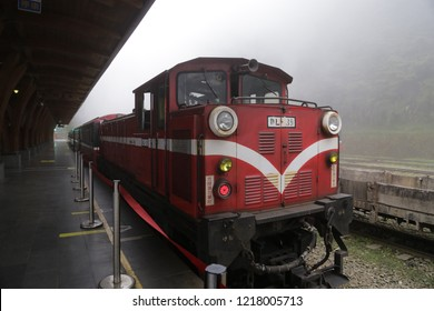 Alishan, Taiwan - 29 April 2018: Alishan train on a foggy day at Alishan Railway Station, Alishan National Forest Recreation Area , Taiwan