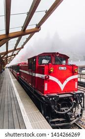 ALISHAN, TAIWAN. DEC 28, 2017: Red train on Alishan Forest Railway stop on the platform of Zhaoping railway station in Alishan, Taiwan.