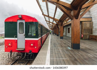 ALISHAN, TAIWAN. DEC 28, 2017: Back of the Red Train on Alishan Forest Railway stop on the platform of Zhaoping railway station in Alishan, Taiwan.