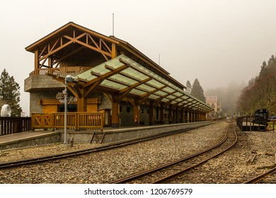 Alishan, Taiwan - December 27 2015: The new Jhaoping Station (after refurbishment) of the Alishan Forest Railway on a foggy day.
