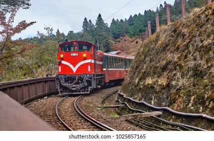 ALISHAN, TAIWAN - NOVEMBER 7, 2017: Train in Alishan on 7 November 2017 in Alishan, Taiwan. You can move around the Alishan Park using a train that travels among the picturesque landscape.