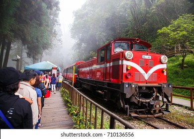 ALISHAN,TAIWAN-AUGUST 20,2017: Many tourists In line to wait for ancient train on a foggy day in the Alishan national park