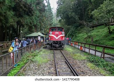 Alishan,taiwan-October 14,2018:Red train stop in foggy day at alishan train station on alishan mountain,taiwan.