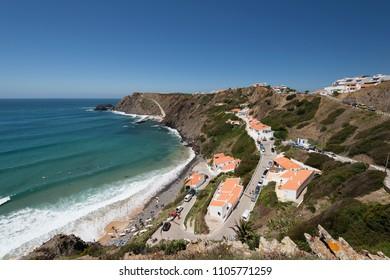 Aljezur, Portugal - April 27, 2018: Elevated view of the Arrifana Beach in Aljezur, Algarve, Portugal. The beach of Praia da Arrifana is inside the Vicentine Coast Natural Park,