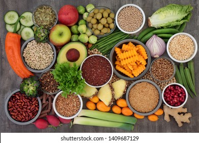 Alkaline health food concept for ph balance with vegetables, fruit, herbs, spice, whole wheat pasta & grains, legumes, green tea, seeds &  nuts. High in omega 3, antioxidants, fibre & vitamins.