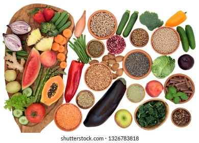 Alkaline health food for ph balance with vegetables, fruit, nuts, seeds, herbs, whole wheat pasta & grains. High in omega 3, antioxidants, anthocyanins, fibre, minerals & vitamins. Top view on white.