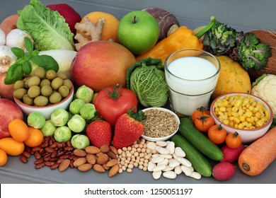 Alkaline healthy food for ph balance with fresh fruit and vegetables, nuts, legumes, herbs, spice and milk. High in omega 3, antioxidants, anthocyanins, fibre and vitamins.
