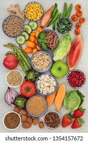 Alkaline super food concept for ph balance with fresh fruit,vegetables, legumes, medicinal herbs, spice, whole wheat pasta, seeds & nuts. High in omega 3, antioxidants, anthocyanins, fibre & vitamins.