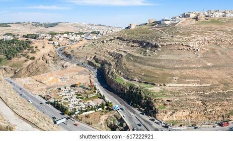 AL-KARAK, JORDAN - FEBRUARY 20, 2012: above view of roads and Al-Karak city from castle. Al-Karak (Karak or Kerak) is a city in Jordan known for its Crusader castle