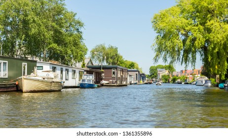 Alkmaar, Netherlands 25.05.2018: Buildings, bridges and parks around the canals of Alkmaar. A boat ride around the city is a perfect escape from the heat of another hot summer in the Netherlands.