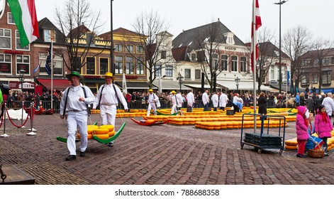 ALKMAAR, NETHERLANDS - April 11, 2013: The main attraction of the town of Alkmaar is the Friday Cheese Market, a real holiday of Dutch cheese for a lot of tourists of all countries
