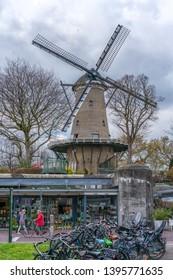 Alkmaar, the Netherlands - April 12, 2019: Beautiful traditional Dutch windmill in Alkmaar, Netherlands