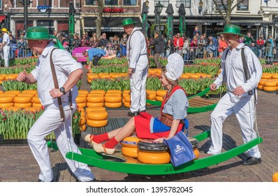 Alkmaar, the Netherlands - April 12, 2019: Traditional cheese market on the Waagplein square in Alkmaar.
