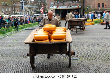 ALKMAAR, NETHERLANDS - APRIL 14, 2017: Dutch cheese market on April 14, 2017 in Alkmaar, Holland. The cheesemarket take place from April until September, every Friday on the Waagplein