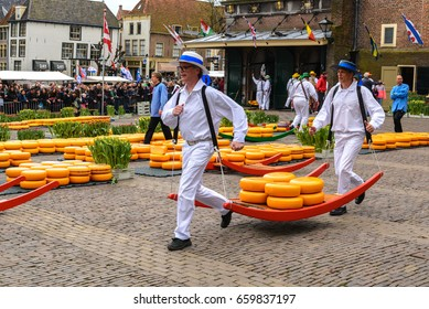 ALKMAAR, NETHERLANDS - APRIL 14, 2017: Dutch cheese market on April 14, 2017 in Alkmaar, Holland. The cheesemarket take place from April until September, every Friday on the Waagplein.