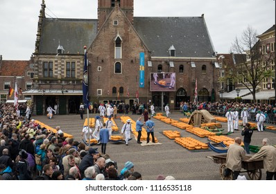 ALKMAAR, THE NETHERLANDS - APRIL 21, 2017: Typical cheese market in the city of Alkmaar in Netherlands, one of the only four traditional Dutch cheese markets still in existence