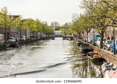 ALKMAAR, NETHERLANDS - APRIL 27, 2018: The historic old town of Alkmaar in North Holland, the Netherlands.  With typical houses, bars and restaurants along the bridges and edges of the canals.