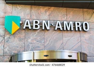 ALKMAAR, NETHERLANDS - AUG 17, 2016: Brand name logo ABN AMRO bank on local branch office in Alkmaar, North Holland,  Netherlands