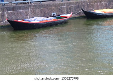 Alkmaar, the the Netherlands - August 04, 2017: Boats full of cheese from the Kaasmarkt in the Dutch town of Alkmaar, the city with its famous cheese market - Travelling through Holland, Netherlands