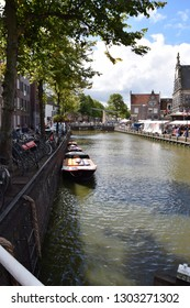 Alkmaar, the Netherlands - August 04, 2017: Boats full of cheese from the Kaasmarkt in the Dutch town of Alkmaar, the city with its famous cheese market - Travelling through Holland, Netherlands
