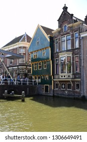 Alkmaar, the Netherlands - August 04, 2017: Historic buildings and bridge in the Dutch town of Alkmaar, the city with its famous cheese market - Travelling through Holland, Netherlands