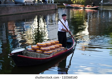 ALKMAAR, NETHERLANDS - AUGUST 10: Cheese arrives to the cheese market by boat on August 10, 2012 in Alkmaar, Netherlands. Every friday morning there is a typical cheese market at Alkmaar.