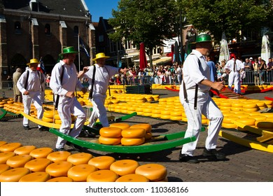 ALKMAAR, NETHERLANDS - AUGUST 10: Cheese carriers at the traditional cheese market on August 10, 2012 in Alkmaar, Netherlands. Every friday morning there is a typical cheese market at Alkmaar.