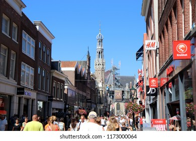 Alkmaar, Netherlands - August 3. 2018 - Street in Alkmaar on a sunny summer day, town hall tower