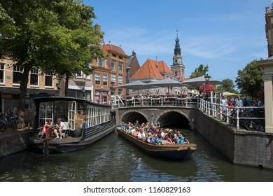 Alkmaar, Netherlands - July 20, 2018: Touristic sight seeing boat trip in the historical center of Alkmaar