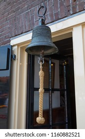 Alkmaar, Netherlands - July 20, 2018: Traditional old bell for ringing at the start of the friday cheese market in Alkmaar