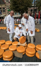 Alkmaar, Netherlands - July 20, 2018: Group of inspectors testing and approving the quality of the cheese at the Alkmaar cheese market