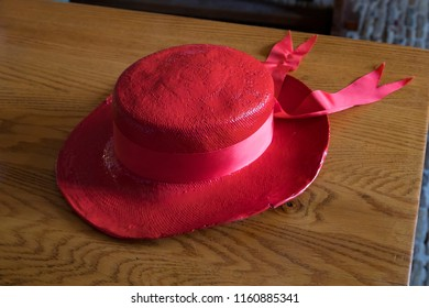 Alkmaar, Netherlands - July 20, 2018: Traditional red cheese carriers hat as a symbol of the Alkmaar guild