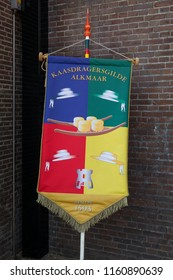 Alkmaar, Netherlands - July 20, 2018: Traditional colorful banner of the cheese carriers guild of Alkmaar