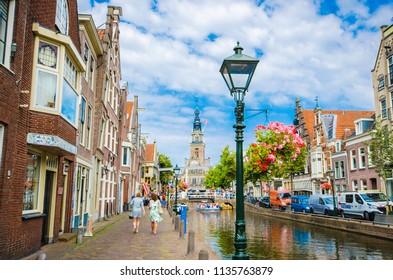 ALKMAAR, NETHERLANDS - JULY, 2018 : The cityscape blue sky in Alkmaar with Waagplein the signature of Alkmaar