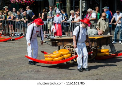 ALKMAAR, NETHERLANDS; JULY 2018 The traditional Friday Cheese Market in the Waagplein square of Alkmaar with many tourist.