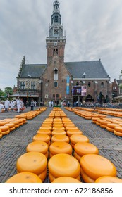 ALKMAAR, THE NETHERLANDS - July 4, Carriers walking with many cheeses in the famous Dutch cheese market, July 4 2017 in Alkmaar, The Netherlands. The event happens in the Waagplein square.