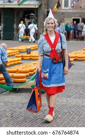 ALKMAAR, THE NETHERLANDS - July 4, Cheese girl at the famous Dutch cheese market, July 4 2017 in Alkmaar, The Netherlands. The event happens in the Waagplein square.