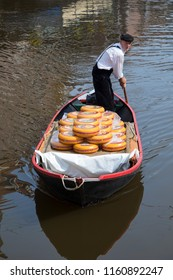 Alkmaar, Netherlands - June 01, 2018: Transport of Gouda cheese by boat from and to the Alkmaar cheese market