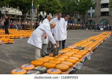 Alkmaar, Netherlands - June 01, 2018: Group of inspectors testing and approving the quality of the cheese at the Alkmaar cheese market