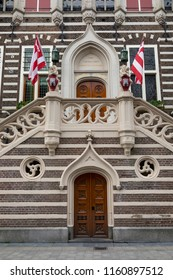 Alkmaar, Netherlands - June 01, 2018: Stairs to the entrance of the townhall of Alkmaar decorated with lions that carry the coat of arms