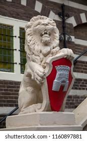 Alkmaar, Netherlands - June 01, 2018: Lion that carries the coat of arms in front of the townhall of Alkmaar
