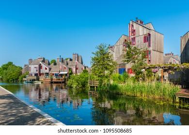 Alkmaar, The Netherlands - May 20, 2018: Modern Neighbourhood with Wooden Houses in Alkmaar, The Netherlands.