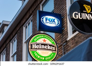 Alkmaar, Netherlands - May 20, 2018: Fox Sports, Heineken and Guinness logos outside bar. Fox Sports live  broadcasts the Eredivisie, the top division of professional soccer in The Netherlands.