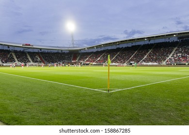 ALKMAAR, NETHERLANDS - OCT 03: Interior view of the full AFAS Stadion on October 03, 2013 in Alkmaar, Netherlands. AFAS Stadion is the home base of the football team AZ Alkmaar.