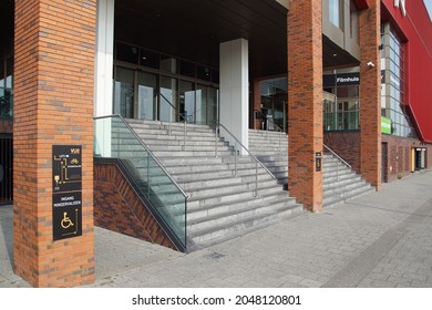 Alkmaar, Netherlands, September 26, 2021. Entrance with stairs of the Dutch cinema building Vue on the road and bicycle path in Overstad, a district of the City of Alkmaar