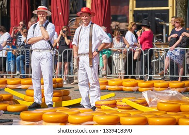 ALKMAAR/NETHERLANDS - April 20, 2018: Cheese carriers standing at the traditional cheese market in Alkmaar.