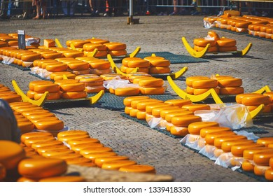 ALKMAAR/NETHERLANDS - April 20, 2018: Huge cheese balls on the ground at the traditional cheese market in Alkmaar