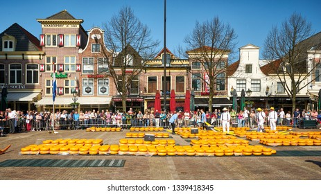 ALKMAAR/NETHERLANDS - April 20, 2018: Traditional cheese market on the Waagplein square in Alkmaar.