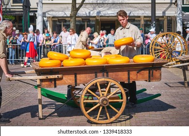 ALKMAAR/NETHERLANDS - April 20, 2018: Wooden wagon with the cheese during traditional cheese market in Alkmaar