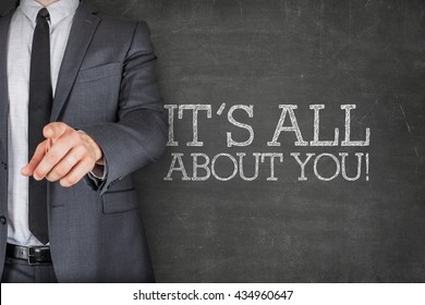 Its all about you on blackboard with businessman